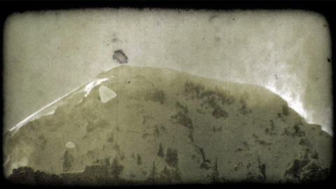 Snowy mountain top 1. Vintage stylized video clip Footage