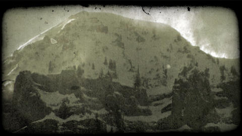 Snowy mountain top 2. Vintage stylized video clip Footage