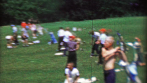 1969: Youth golf clinic day young boys hitting balls hot summer day driving rang Footage