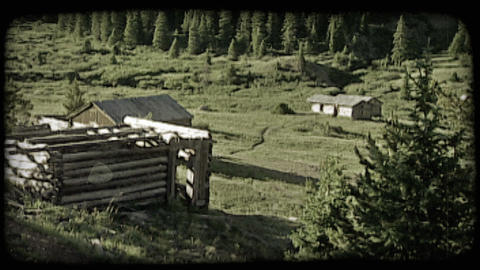 Old cabin in mountains. Vintage stylized video clip Live Action