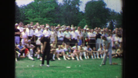 1969: Golf tournament practice session expo men hitting balls driving range Footage