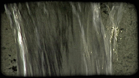 Clear water falling off ledge. Vintage stylized video clip Footage