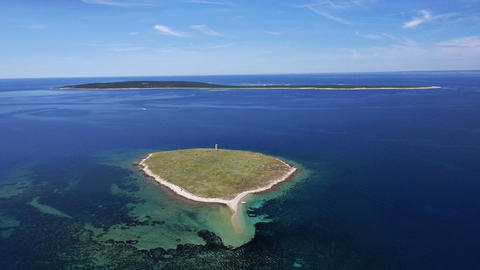 Aerial - Two small Croatian islands with green land and nice blue water around Footage
