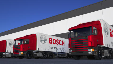 Freight semi trucks with Robert Bosch GmbH logo loading or unloading at Live Action