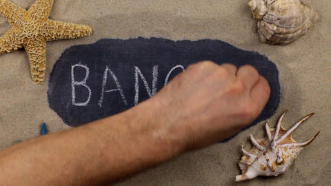 Handwritten word BANGKOK written in chalk, among seashells and stars. Top view Live Action