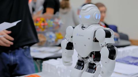Humanoid robot dancing at robotic show GIF