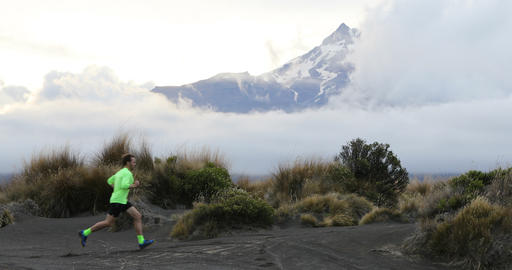 Running man trail runner enjoying sports run in New Zealand mountains nature ビデオ