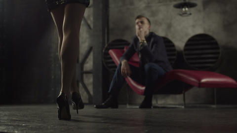 Elegant woman flirting with confident man indoors Footage