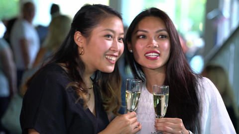 Celebration scene - two girls drink champagne and chat on a party Footage