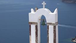 Greece Aegean Sea Cyclades Santorini OIa ferryboat deep below bell of church ビデオ