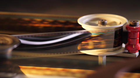 The fascination of cinema - 35mm film projected in a movie theater Footage
