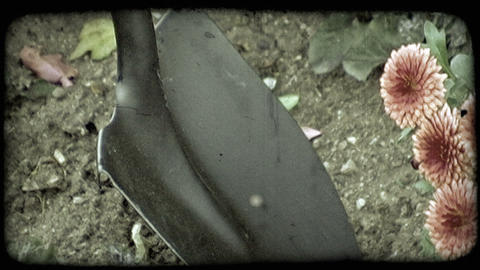Close up of foot pushing shovel into ground. Vintage stylized video clip Footage