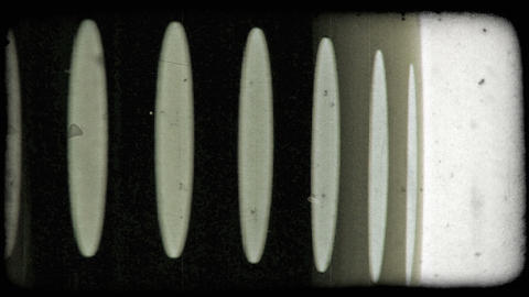 A cylinder object spinning with midsection spinning a bit more slowly. Vintage s Footage