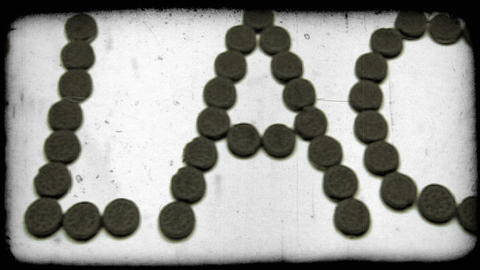 The word black spelled out using chocolate sandwich cookies. Vintage stylized vi Footage