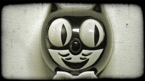 Close-up shot of a Felix the Cat clock. Vintage stylized video clip Footage