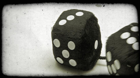 Shot of two black dice rolling on the floor. Vintage stylized video clip Footage