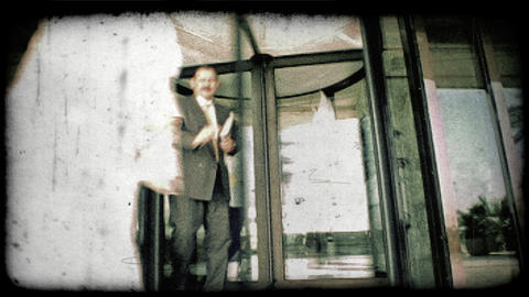 People walk through revolving door 1. Vintage stylized video clip Footage