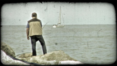 Fisherman and Sailboat. Vintage stylized video clip Footage