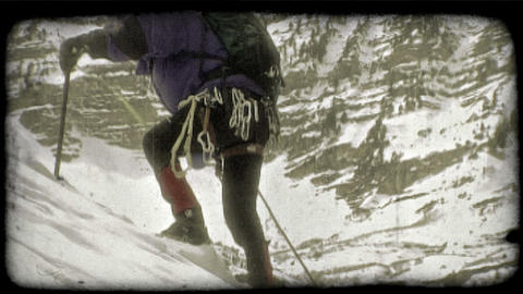Mountain climber ascends mountain. Vintage stylized video clip Footage