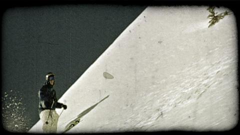 Man skis through powder. Vintage stylized video clip Footage