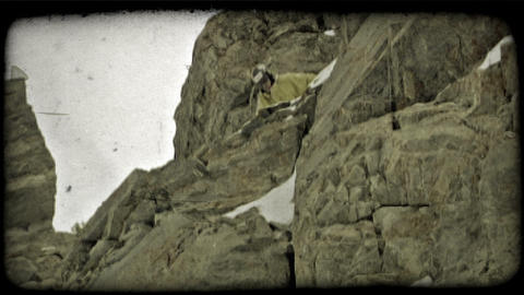 Expert skier jumps off rocky hill. Vintage stylized video clip Footage