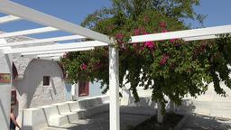 Greece Aegean Sea Cyclades Santorini Oia white bungalow with public toilets GIF