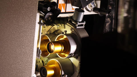 Film runs through a 35mm projector in a movie theater Footage