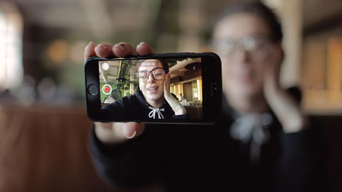 Young Blogger Recording Video on Smartphone Live Action