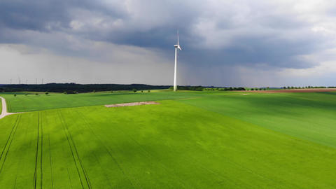 Wind energy plant - modern wind power station on a hill - clean energy Footage