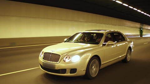 Luxury car models in tunnel Live Action