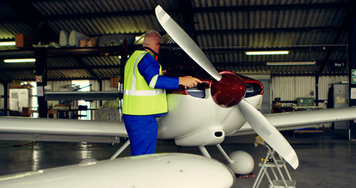 Engineer fixing an aircraft in hangar 4k Live Action