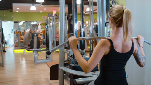 Girl in a fitness studio - daily training for a perfect body Footage