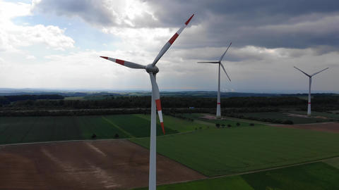 Aerial flight over wind power plants - wind energy mills… Stock Video Footage