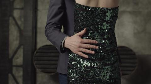 Male hand embracing woman's slim waist indoors Footage