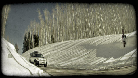 SUV drives down hill. Vintage stylized video clip Live Action
