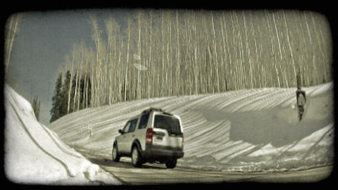 SUV drives up hill 1. Vintage stylized video clip Live Action