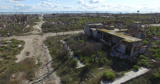 Aerial Drone scene of demolished destroyed city. Camera panning over an abandone Footage