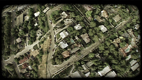 Aerial over homes 1. Vintage stylized video clip Footage