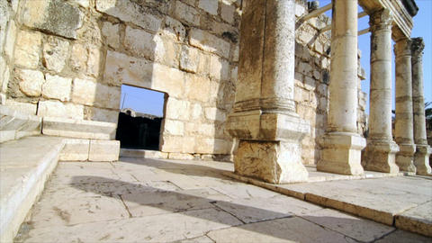 Slow-moving, angled tracking footage of ancient synagogue ruins Footage