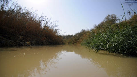 Slow-moving water of the Jordan river Footage