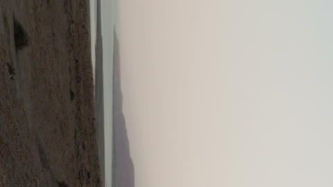 Vertical shot of Time lapse of fog on the banks of the Sea of Galilee Footage