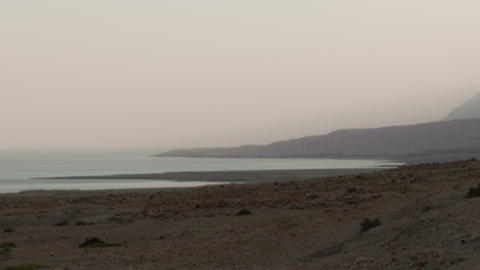 Panning shot of Time lapse of fog on the banks of the Sea of Galilee Footage