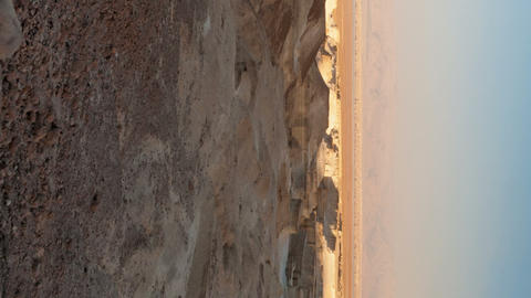 Vertical shot of Panoramic shot of shadows moving across desert landscape Live Action