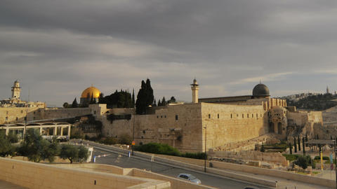Panning shot of Low-angle time lapse of street below Dome of the Rock Live Action