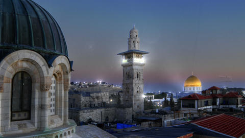 Panning shot of Time lapse of sunset over Jerusalem rooftops, including Dome of  Live Action