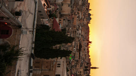 Vertical shot of Time lapse of sunset over Jerusalem rooftops Footage