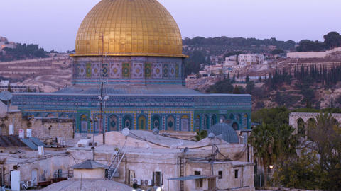 Panning shot of Close up time lapse of the Dome of the Rock as night falls Footage
