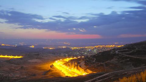 Panning shot of Time lapse of dawn breaking over Jordan Footage