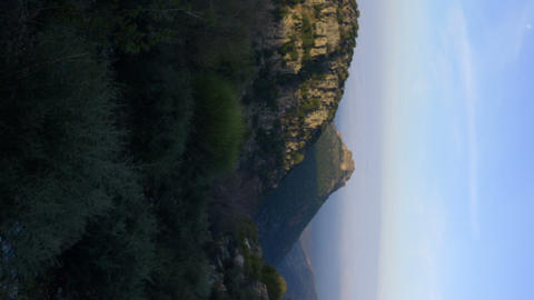 Vertical shot of Time lapse of sunlight gradually covering hills Footage