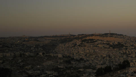 Panning shot of Sunset from behind shot of Jerusalem Footage